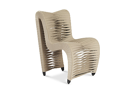 angled view of the Phillips Collection Seat Belt Beige Dining Chair which is made of straps that are woven to create a sculptural shape from interlocking bands
