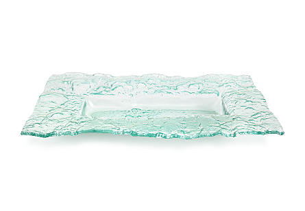 angled view of the Phillips Collection Bubble Glass Dish made of glass with a turquoise sheen that is stamped with a flowing bubble pattern