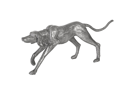 angled view of the Phillips Collection Walking Dog Sculpture that is made of aluminum in a variegated finish in which black and silver bring it added patina