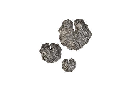 front view of the Lotus Leaf Wall Tile Set by Phillips Collection a set of textural silver and black wall sculptures shaped like lotus leaves