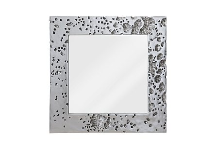 front view of the Phillips Collection Splotch Silver Mirror a decorative mirror made of composite in a silver leaf finish with craters along the frame