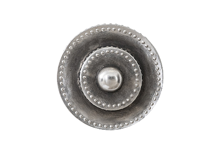 Phillips Collection Circles Silver Patina Wall Tile is an industrial chic wall sculpture that is shaped like the end of a trumpet