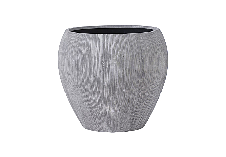 Phillips Collection's Brianna String Medium Planter is a garden planter made of composite in a raw gray finish with contemporary lines