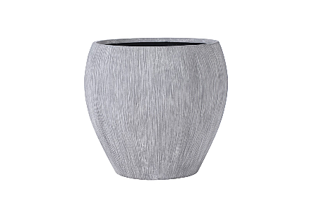 Phillips Collection's Brianna String Large Planter is a garden planter made of composite in a raw gray finish with contemporary lines