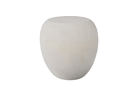 Phillips Collection River Stone Ivory Side Table is an off-white side table shaped like a rock