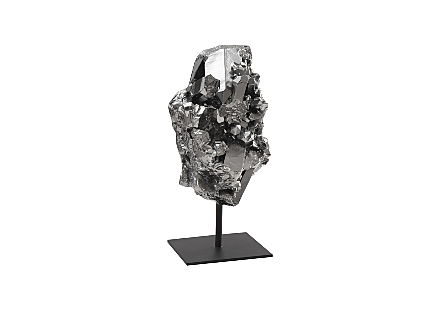 Phillips Collection Cast Crystal Small Liquid Silver Sculpture is a silver sculpture shaped like a diamond dug from the ground