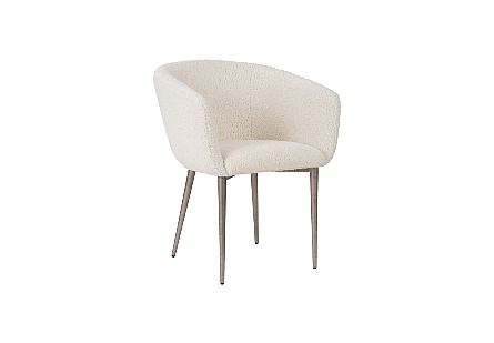 Phillips Collection Curve Faux Sheep Wool Dining Chair is an ivory club chair with an iconic mid-century modern design