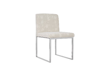 Phillips Collection Frozen Off-White Dining Chair is a contemporary chair with an ivory upholstery fabric and stainless-steel frame.