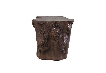front view of the Log Bronze Side Table by Phillips Collection a log side table made of composite to look like a slice of a tree trunk with knots