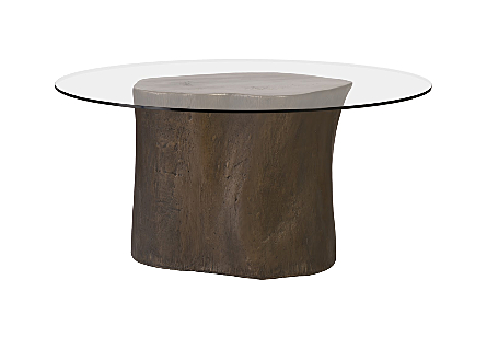 front view of the Log Bronze Dining Table by Phillips Collection with glass top a log dining table made of composite to look like a slice of a tree trunk with knots