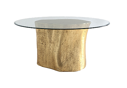 front view of the Log Gold Dining Table by Phillips Collection with glass top a log dining table made of composite to look like a slice of a tree trunk with knots
