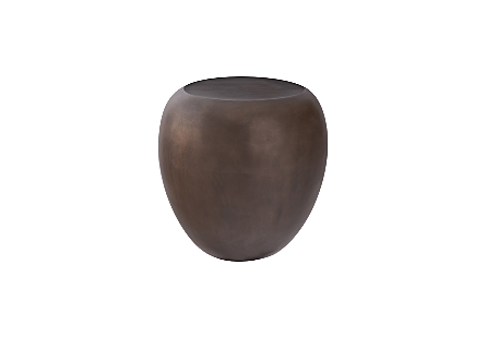 front view of the Phillips Collection River Stone Bronze Side Table a rock-shaped side table made of composite in a warm bronze finish