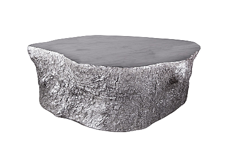 front view of Phillips Collection Bark Silver Coffee Table a coffee table shaped like a slice of a tree trunk in a luminous silver leaf finish