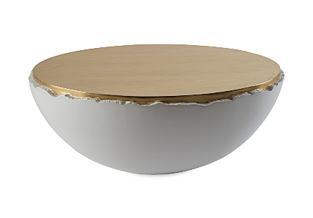 front view of the Broken Egg Coffee Table by Phillips Collection a white coffee table with a mix of luminous gold leaf and pearl white finishes