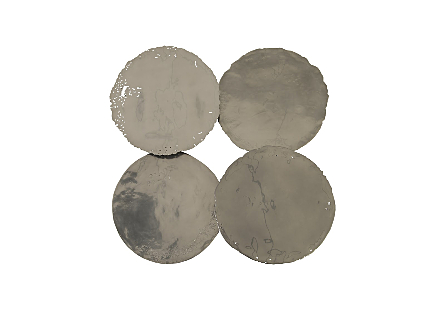 the Phillips Collection Liquid Silver Cast Oil Drum Wall Discs are decorative wall sculptures that look aged covered in a silver finish