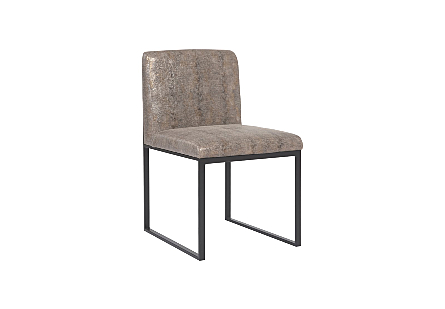 angled view of the Phillips Collection Frozen Python Black Dining Chair a modern chair with a python gold upholstery fabric and matte black metal frame