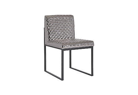 angled view of the Phillips Collection Frozen Platinum Black Dining Chair a modern chair with a quilted platinum fabric and matte black metal frame