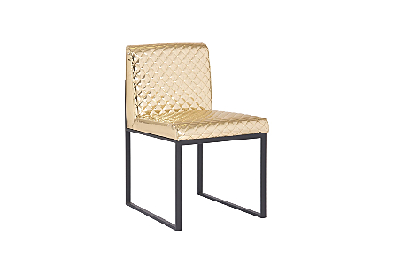 angled view of the Phillips Collection Frozen Gold Black Dining Chair a modern chair with a quilted gold fabric and matte black metal frame