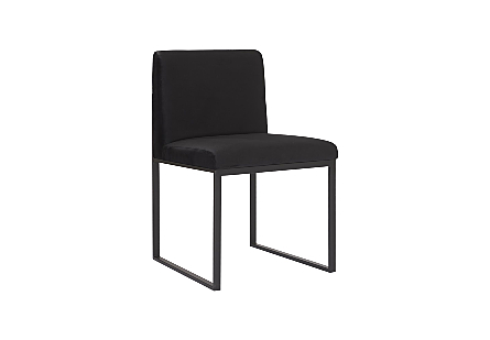 angled view of the Phillips Collection Frozen Black Velvet Dining Chair a modern chair with a black velvet fabric and matte black metal frame