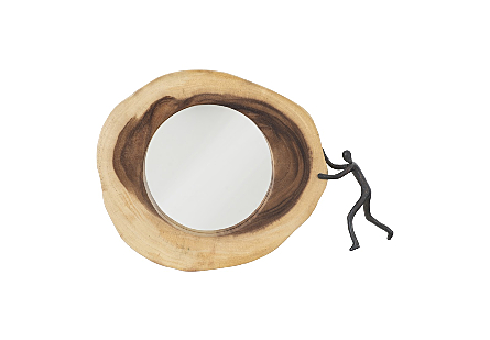 front view of Figure Balancing Cross Cut Mirror by Phillips Collection an organically shaped round wood decorative mirror with a sculptural figure