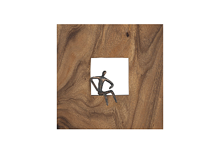 the Phillips Collection Akimbo Figure Square Wall Decor a piece of wall art made of wood with a sculptural metal figure in bronze
