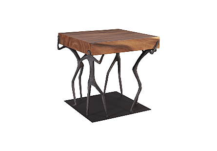 side view of the Phillips Collection Atlas Natural Side Table a wood slab side table with sculptural figures atop a black base supporting the wood top