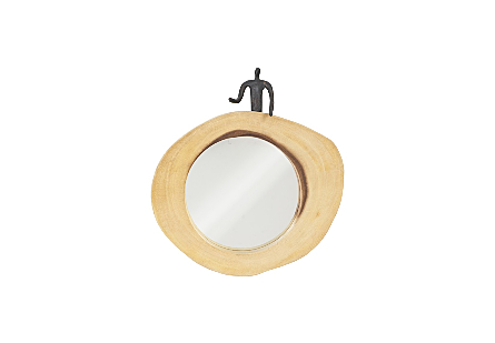 front view of Pointing Figure Cross Cut Mirror by Phillips Collection an organically shaped round wood decorative mirror with a sculptural figure