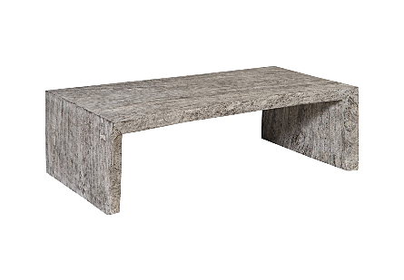 angled view of the Phillips Collection Waterfall Gray Coffee Table with a clean profile with ample personality thanks to the chamcha wood it is made from