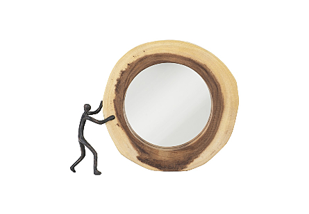 front view of Figure Pushing Cross Cut Mirror by Phillips Collection an organically shaped round wood decorative mirror with a sculptural figure
