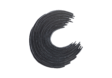 Phillips Collection Swoop Wall Art is a black sculpture with uneven bands of wood curved and wrapped in an asymmetrical design