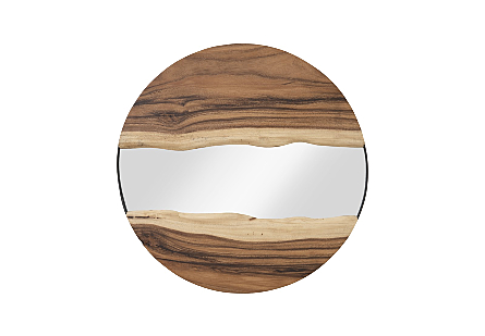 Phillips Collection River Mirror is a decorative mirror with panels of chamcha wood that flow at the top and bottom of the round mirror