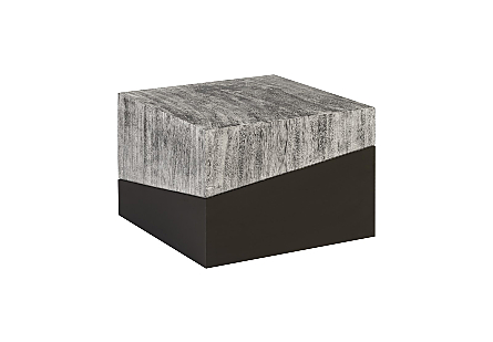 angled view of the Geometry Square Gray Coffee Table by Phillips Collection which is made of slanting sections of gray woodgrain and sleek black