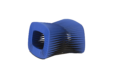 angled view of the Phillips Collection Seat Belt Blue Ottoman which is made of straps woven to create a sculptural shape from interlocking bands