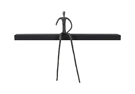 front view of the Long Moveable Pointing Man Shelf by Phillips Collection with a whimsical bronze figure that can move around its black wood shelf